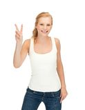 Girl in blank white t-shirt showing victory sign Royalty Free Stock Photography