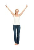 Girl in blank white t-shirt showing victory sign Royalty Free Stock Image