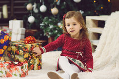 Girl on Blanket with Presents Stock Photos