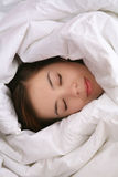 Girl in Blanket Sleeping Royalty Free Stock Image