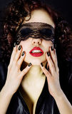 Girl blindfolded lace of Stock Images