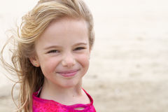 Girl with blond hair smiling at beach Royalty Free Stock Images