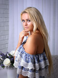 Girl with blond hair standing in a half-turn Royalty Free Stock Photo