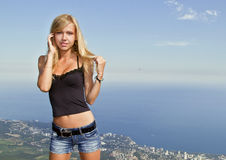 The girl the blonde against the blue sky Royalty Free Stock Image