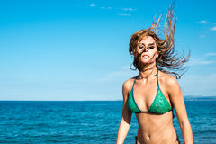 Girl blonde on the beach try a dancer Royalty Free Stock Image