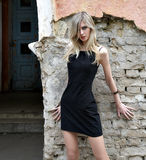 The girl the blonde in a black dress Stock Image