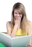 Girl the blonde with the book in hands Royalty Free Stock Photo