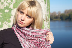Girl the blonde close up on river bank royalty free stock images