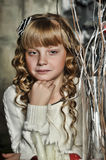 Girl with blonde curls Stock Images