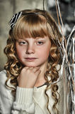 Girl with blonde curls Stock Image