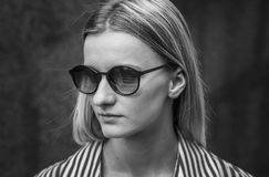 Girl blonde with dark glasses in a frame, day, outdoor. Posing o stock photo