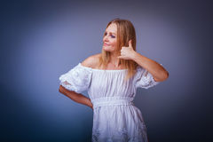 Girl blonde European appearance in a white dress Stock Photography