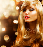 Girl with Blonde Hair. Blond Fashion Girl. Blonde Hair. Golden background