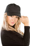Girl with blonde hair in cap Stock Photos