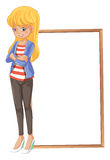A girl with a blonde hair beside a frame Stock Photos
