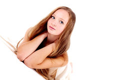 Girl with blonde hair lie with white towel Stock Photography