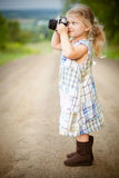 Girl With Blonde Hair and Wearing Blue and White Plaid Dress and Capturing Picture during Daytime Stock Photos
