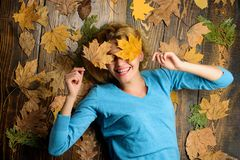 Girl blonde lay on wooden background with orange leaves top view. Fall and autumn season concept. Fall atmosphere. Attributes. Woman pretty lady enjoy season royalty free stock photos