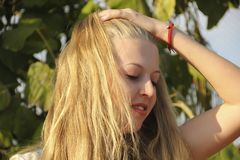 Girl blonde long hair portrait. In nature royalty free stock image