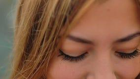 Girl blonde look flirting big eyes slow motion stock video