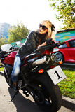 The girl blonde on red motorcycle Royalty Free Stock Photos