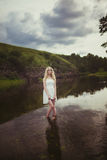 Girl blonde. In the river Stock Photography