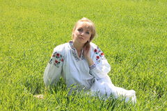 Girl blonde in the spring of Ukrainian embroidery stock photos