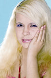 Girl the blonde suffers from a toothache Royalty Free Stock Photography