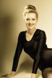 Girl blonde woman in hair bun royalty free stock photography