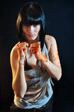 Girl with bloody hands in boxing pose Royalty Free Stock Photos
