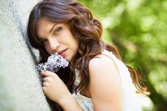 Girl in blooming garden Stock Photos