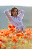 Girl at blooming poppy field Stock Photo