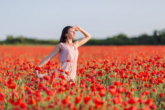 Girl at blooming poppy field Royalty Free Stock Images