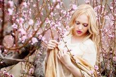 Girl in blossom garden stock photo