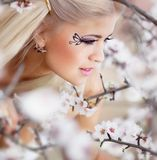 Girl in blossom garden Stock Image