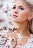 Girl in blossom garden Stock Image