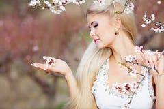 Girl in blossom garden Royalty Free Stock Image