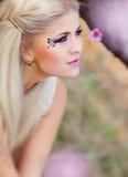 Girl in blossom garden Royalty Free Stock Photos