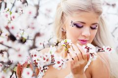 Girl in blossom garden Royalty Free Stock Photo