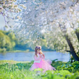 Girl in blossom park Royalty Free Stock Images
