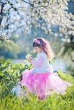 Girl in blossom park Stock Photos