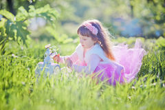 Girl in blossom park Stock Photography