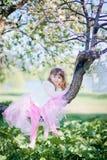 Girl in blossom park Stock Image