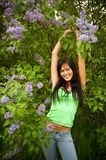 The  girl and blossoming lilac Royalty Free Stock Photo