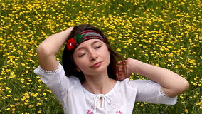 Girl on a blossoming meadow stock video
