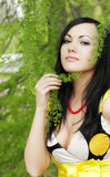 Girl and blossoming spring plants Stock Photography