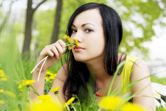 Girl and blossoming spring plants royalty free stock photography
