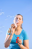 Girl blow bubbles Stock Photo
