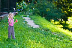 Girl blow bubbles Stock Images