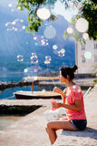 Girl blow bubbles on beach Stock Images